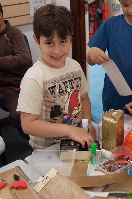 Boy Participating in Craft Event